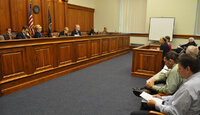 Attendees testify at a Michigan Senate Judiciary Committee meeting.