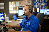 A dispatcher takes 911 calls in Milwaukee, Wis.