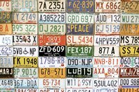 A collection of vintage license plates.