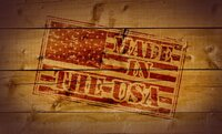 Made in the USA rubber stamp on wooden background.