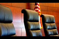 The chairs for a three-judge panel of the Court of Appeals in their courtroom in the Iowa Judicial Building.