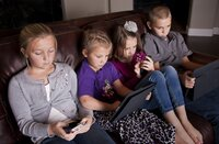 Kids using smartphones.