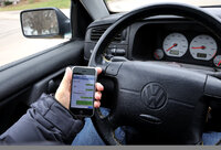 driver in car with cellphone