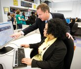 Joseph Morrisroe, executive director of NYC 311, works with a staff member in the city's call center