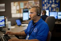 911 dispatcher takes calls