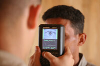 An Iraqi recruit gets processed through the Biometric Automated Tool Set System