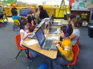 Kindergartners on laptops
