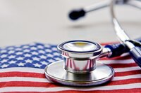 Stethoscope on an American flag to represent health care reform