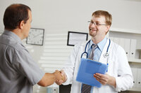 Doctor shaking hands with a patient to illustrate the Affordable Care Act