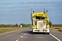 Yellow big rig truck after a crash