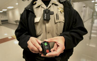 Shelby County Sheriff's Department SRO Joseph Fox displays the department's new body cameras