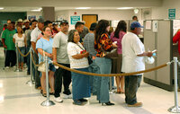 People line up at a California Employment Development Department office