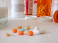 Pills and pill bottles on a table.