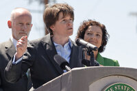 Seattle City Council President Sally Clark speaks to reporters.