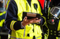 Firefighter using a tablet