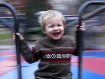 Happy child on a merry-go-round