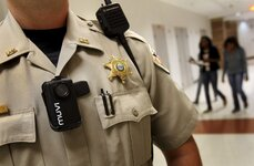 A school resource officer wears a personal body camera while on duty