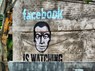 Facebook is watching mural in a public space