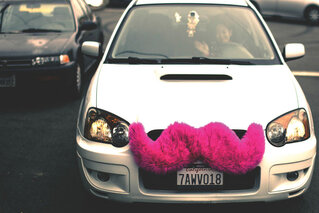 Lyft, a ride-sharing company, requires a hot pink mustache on the grille of each driver's personal vehicle.