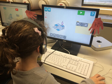 Third grader participates in the Hour of Code