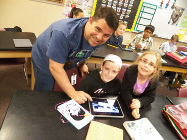 teacher with students, tablets