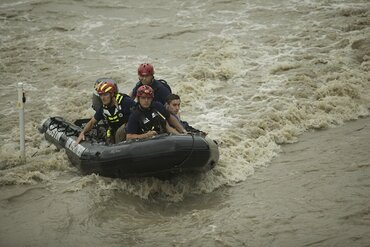 Rescue personnel from the Austin Fire Department bring a man to safety