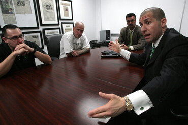The CEO and manager of a Fresno, Calif.-based business, right, discuss why their company hires ex-offenders.