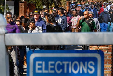 Early voters line the sidewalk in Columbia, S.C. Thirteen states have introduced bills to initiate or expand early voting this year.