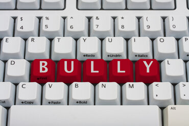 Cyberbully written on computer keyboard