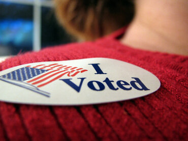 """Woman wearing """"I voted"""" sticker"""