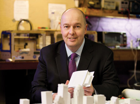 Ted Smith, chief of economic growth and innovation, Louisville, Ky., with a 3-D printed model of the city