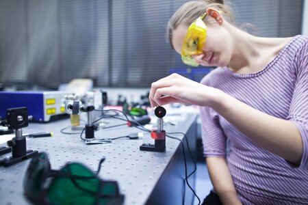 STEM student experimenting in a lab
