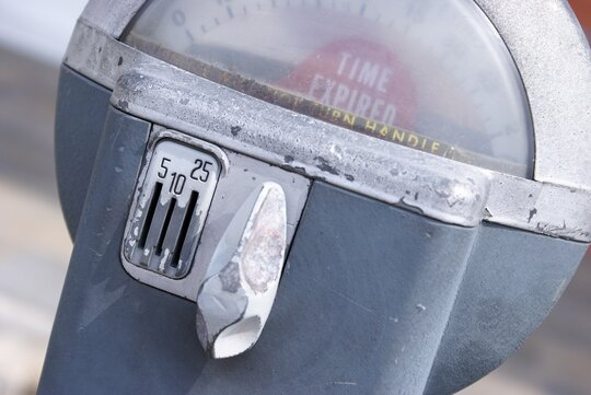 A coin-operated parking meter.