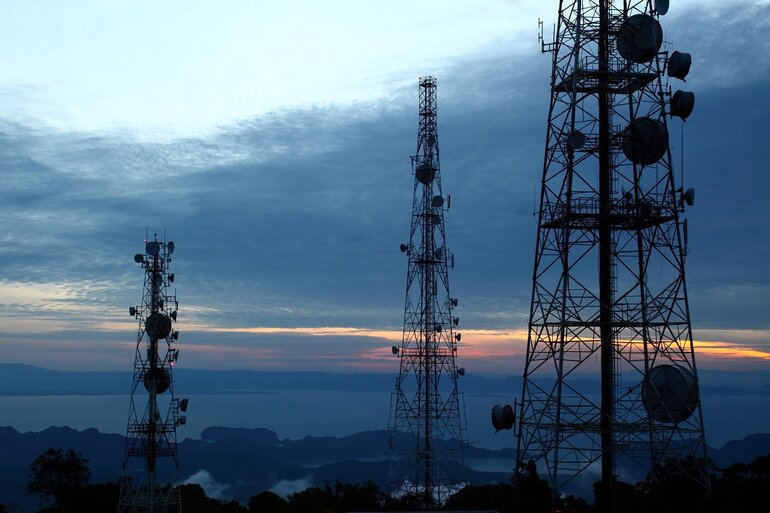 Three cellular communications towers.