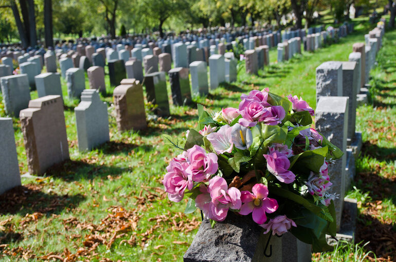 Headstones and flowers in a cemetery.