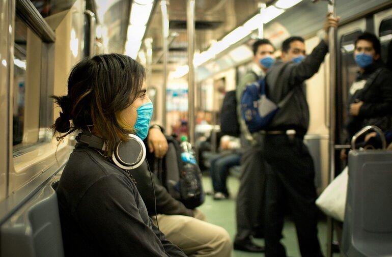 Citizens wearing masks to help prevent infection.