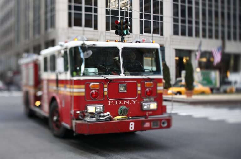 A fire engine driving through an intersection.
