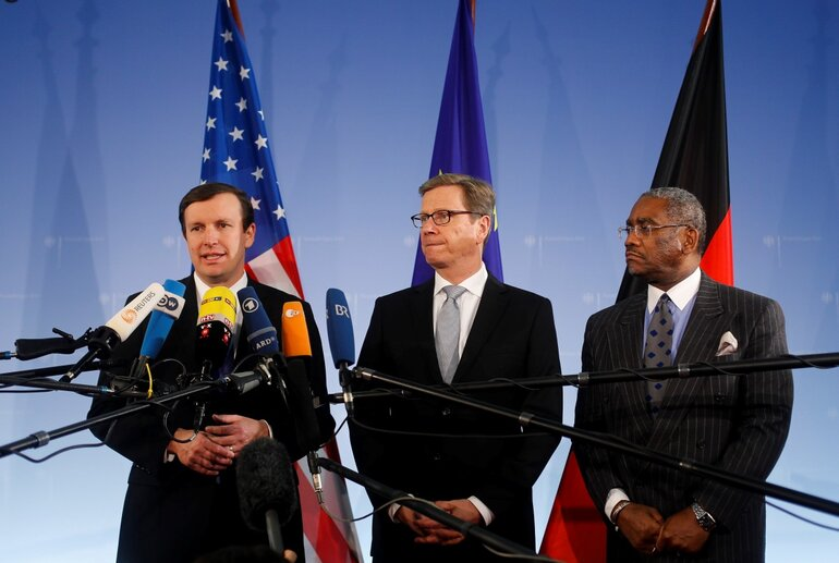 Connecticut Sen. Christopher Murphy, left, briefs the media prior to a meeting with Congressman Gregory Meeks, right, and German Foreign Minister Guido Westerwelle, center, at the foreign ministry in Berlin