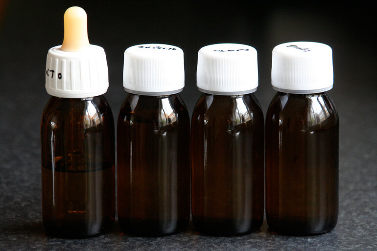 small bottles of liquid, prepared to be screened by airport security