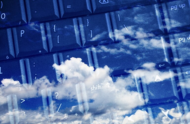 Cloud imagery against a computer keyboard