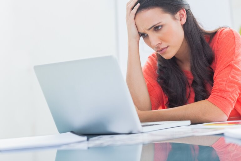 confused or frustrated woman looking at a laptop screen