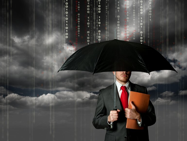 Umbrella protects man from storm of binary numbers to depict cyber insurance