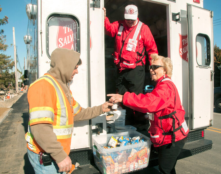 Salvation Army passing out supplies.