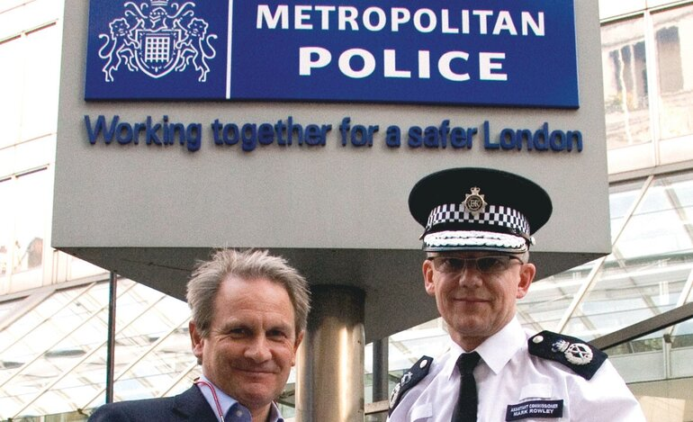 Simon Gordon (left), owner of Gordon's Wine Bar in London, and Assistant Commissioner Mark Rowley of the London Metropolitan Police Service
