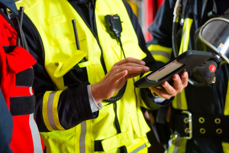 Fire personnel using a tablet