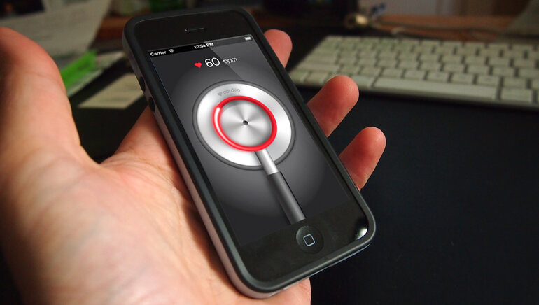 A smartphone with a display of a heart rate app