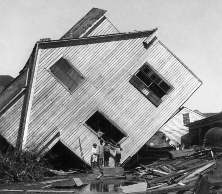 A house tipped on its side in the aftermath of the Galveston, Texas hurricane of 1900