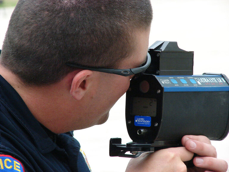 Police officer with a radar gun