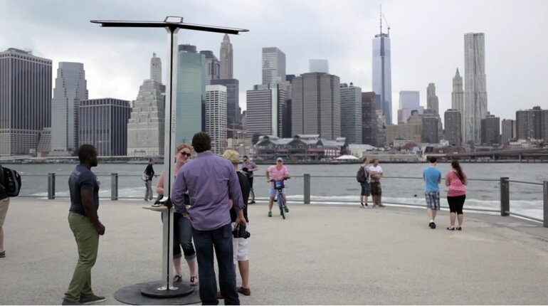 Solar-powered mobile device charging station in New York City