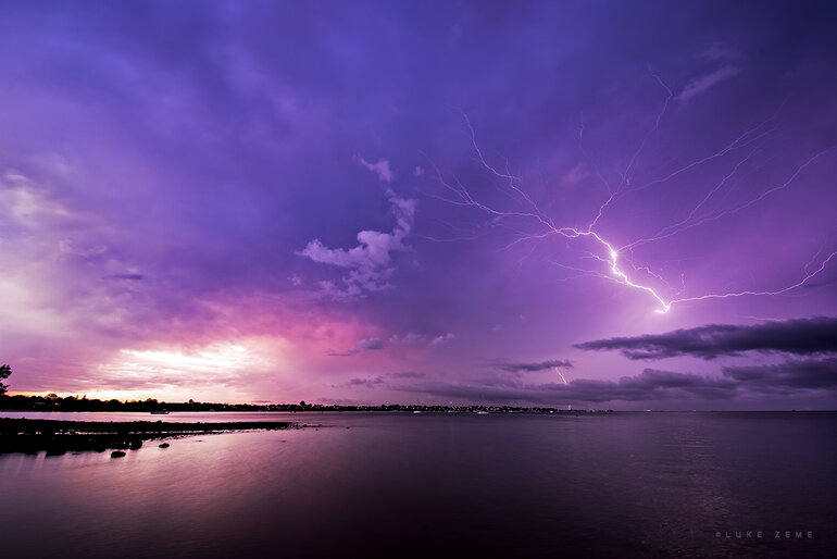 Purple lightning over the water